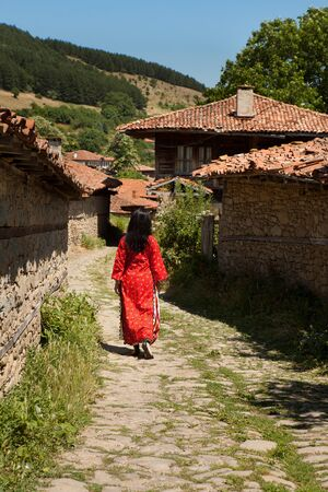 bulgarian ethnicity: National costume woman walking the streets of Jeravna in Bulgaria