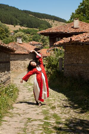 bulgarian ethnicity: Bulgarian folklore in national costume in the traditional village of Jeravna Stock Photo