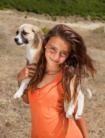 bulgaria girl: Beautiful mountain shepherd girl from Bulgaria posing with her puppy Stock Photo