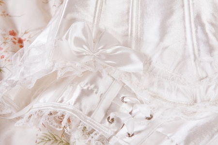 Detail of a sexy white corset on a bed waiting for the bride Stock Photo - 13859951