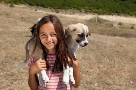 bulgaria girl: Teenage shepherd girl from Bulgaria holding a puppy Stock Photo