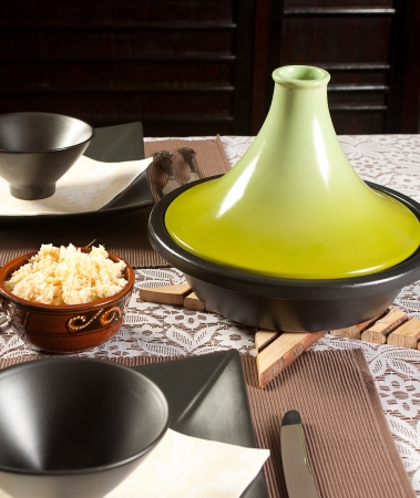 moroccan cuisine: Modern tajine pot on a dinner table for moroccan cuisine Stock Photo