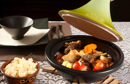 couscous: Homemade tajine dish and fresh couscous on a table