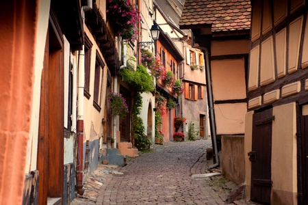wooden houses: Street with half-timbered medieval houses in Eguisheim village along the famous wine route in Alsace, France