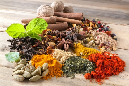 curry spices: Mixture of beautiful spices and herbs on a wooden table Stock Photo