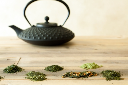 chinese teapot: Six different Japanese teas in the form of tea leaves and ground tea