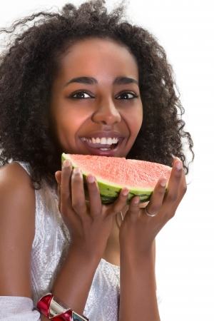 Summer portrait of an African Ethiopian girl with a slice of melon photo