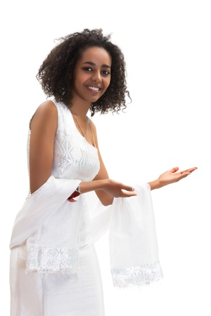ethiopian ethnicity: Isolated image of a young Ethiopian woman making a welcome gesture in her traditional dress