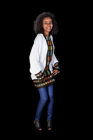 Pretty Ethiopian girl doing the traditional shoulder dance photo