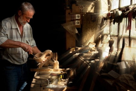 artisan: Summer sun beams shining on the hands of a skilled carpenter