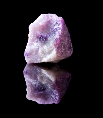 Rough unpolished specimen of fluorite crystal, a calcium fluoride mineral photo