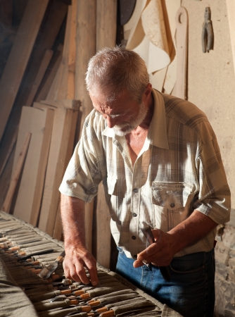 carpentry tools: Skilled wood worker choosing the tools to work with wood Stock Photo