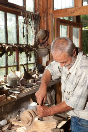 carpenter's sawdust: Vintage shed and a skilled carpenter working with wood Stock Photo