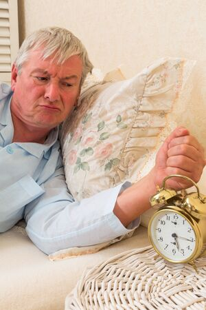 grumpy old man: Grumpy old man waking up in the morning Stock Photo