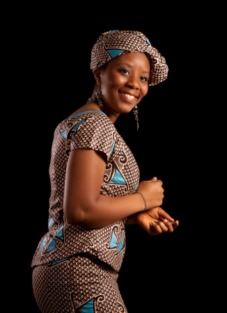 Attractive Ghanese african woman showing a dance in her traditional national costume Stock Photo - 14663376