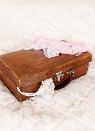 Suitcase of a bride with cream and blue garter and lace lingerie Stock Photo - 14670940