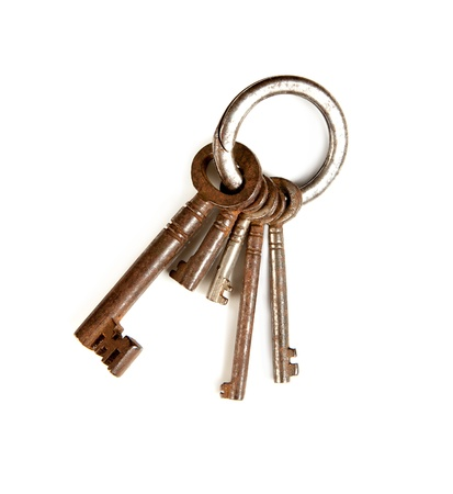 keyring: Key-ring isolated on white with rusty keys in different sizes Stock Photo
