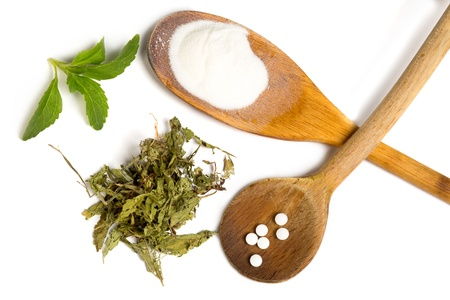 sweetener: Stevia sweetener as powder dried and tablets isolated on white