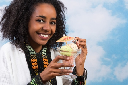 Happy African Ethiopian woman eating an icecream Stock Photo - 14747390