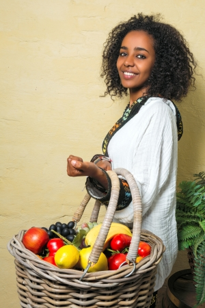 traditional costume: Happy Ethiopian girl wearing a traditional costume Stock Photo