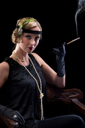 headband: Twenties lady smoking a cigarette with a cigarette holder