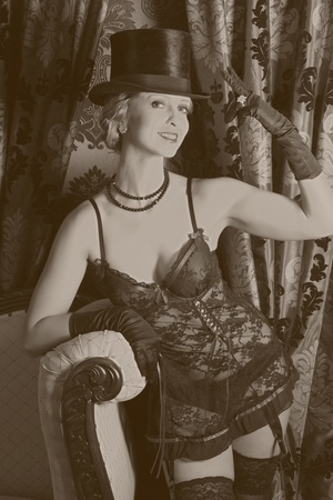 rouge: Sepia old photo effect of a retro woman in moulin rouge style