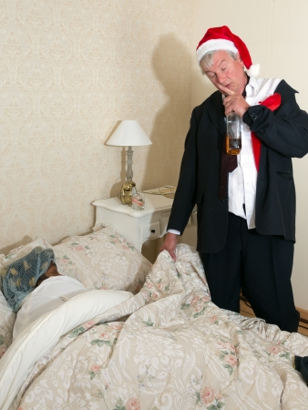 Vintage husband coming home drunk and getting to bed Stock Photo - 14747378