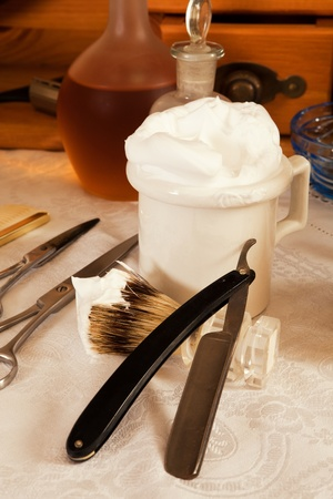 barber shave: Razor blade and shaving cream in a victorian barbershop Stock Photo