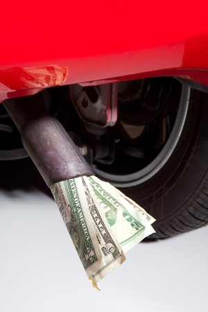 car exhaust: Energy crisis and expensive fuel symbolised with euros in a car exhaust pipe