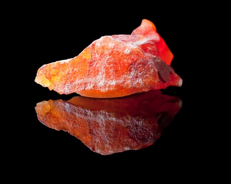 Jasper is an ornamental rock composed mostly of chalcedony, microcrystalline quartz, together with other minerals, which give it colourful bands  Stock Photo