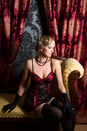 Retro boudoir room and sexy woman wearing twenties style corset photo