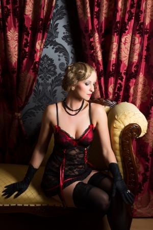 rouge: Retro boudoir room and sexy woman wearing twenties style corset