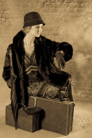 titanic: Vintage woman in twenties style waiting for the train