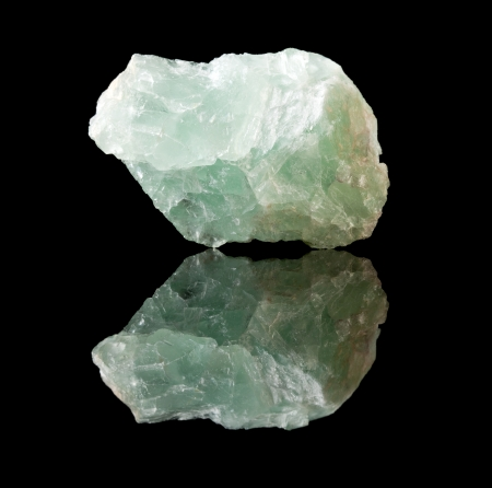 unpolished: Uncut unpolished specimen of fluorite crystal, a calcium fluoride mineral