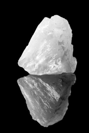 Rough rock piece of milky or white quartz as it is found in nature Stock Photo