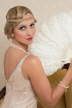 Vintage twenties lady wearing a headband and flapper dress photo