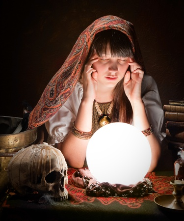 scrying: Diviner predicting the future with a crystal ball Stock Photo