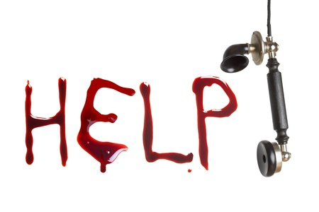 cry for help: Hanging telephone receiver and bloody letters as a cry for help Stock Photo