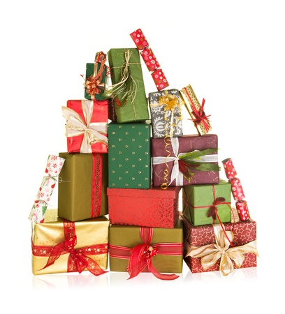 Big stack of christmas presents in the shape of a high mountain photo