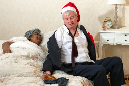 Funny bedroom scene of an angry wife and a drunk husband coming home photo