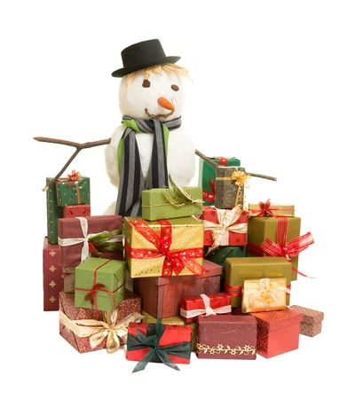 Large snowman surrounded by colorful christmas presents photo