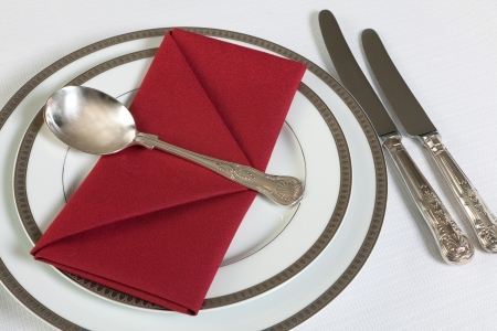 Red napkins folded as an envelope or letter on an elegant dinner table photo