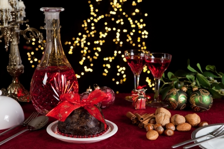 wine sauce: Christmas dinner table with xmas pudding as dessert Stock Photo