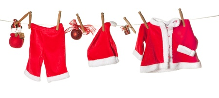 Baby clothes for christmas and gifts hanging on a clothesline Stock Photo