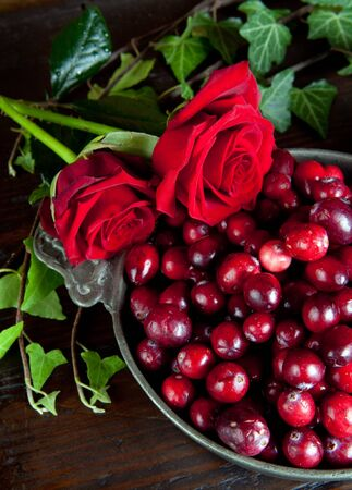 stilllife: Thanksgiving still-life with cranberries and red roses