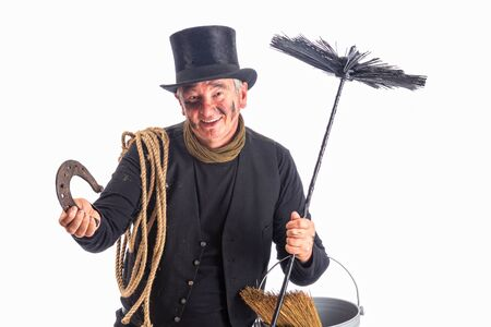chimney sweep: New Year image of a chimney sweep wishing good fortune with a horseshoe Stock Photo