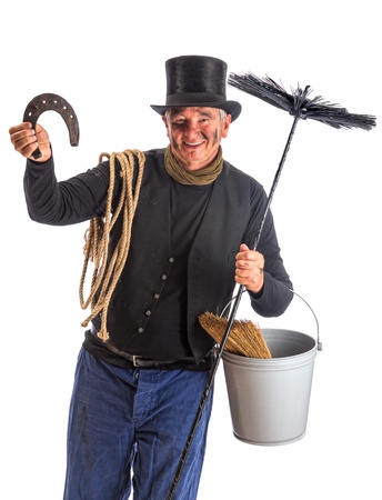 Isolated image of a chimney sweep whishing good fortune with a horseshoe photo
