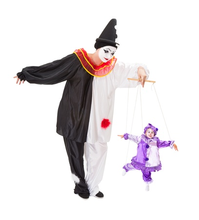 harlequin clown in disguise: Pierrot playing with a living clown as a marionette puppet on strings
