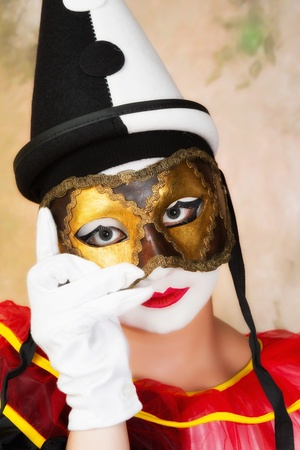 pierrot: Painted pierrot holding a leather venice mask