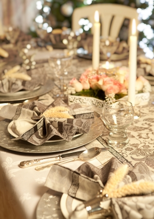 Decorated napkins and flowers on a luxury christmas dinner table photo